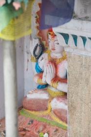 The four armed Buddha of compassion on a street corner near Svayambhu Stūpa