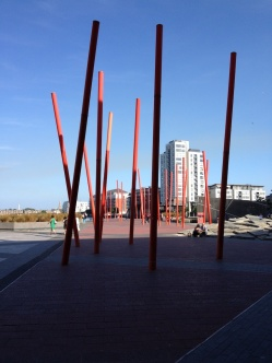 Red poles sticking out of the ground and the docks area in eastern Dublin