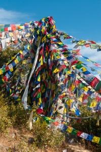 Prayer flags above the Padmasambhava cave