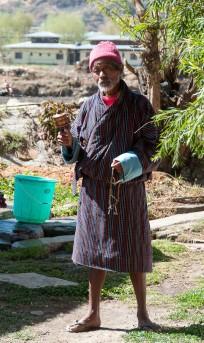 Bhutanese gentleman with a handheld prayer wheel